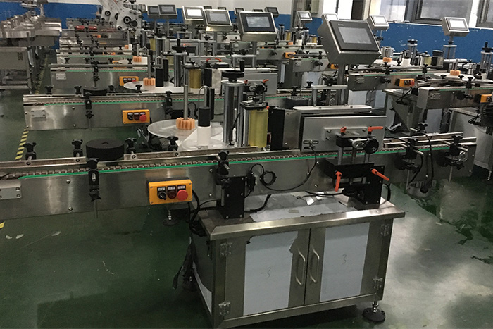 The round can two-sided labeling machine